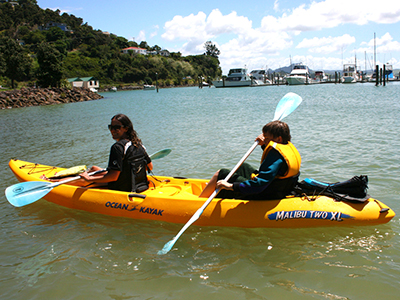 Things to do in Taupo Bay Northland New Zealand - family fun kayaking in Whangaroa Harbour